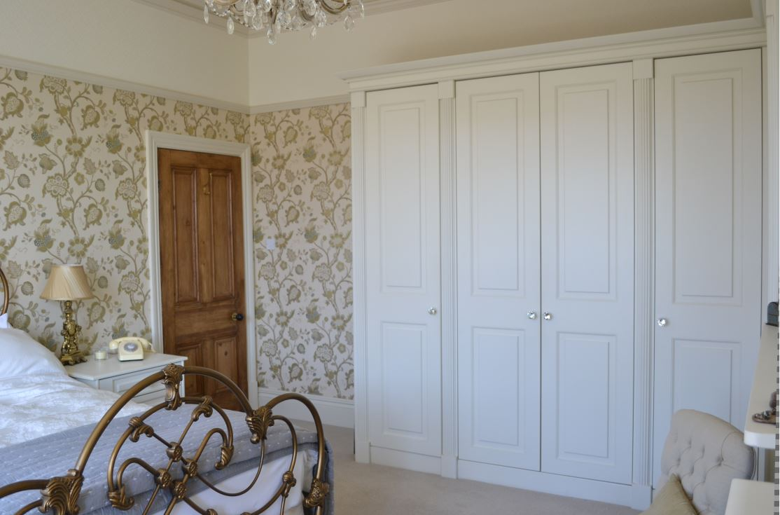 Bespoke, Farrow & Ball painted, luxury fitted wardrobes with #Swarovski Crystal.handles for the luxurious finishing touch.