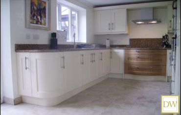 Bespoke natural oak kitchen painted  in ivory with feature curved doors and drawers.