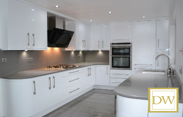 Ever popular, white gloss kitchen with #Neff appliances & #Silestone worktops