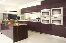 This contemporary style kitchen oozes luxury  - solid acrylic doors by Parapan mixed with walnut.
