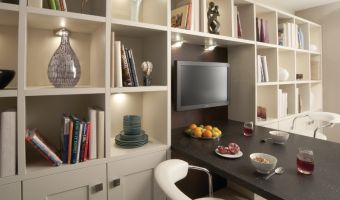Tailor made shaker style furniture with ample of storage and display shelving  - results in a modern, light and practical solution.