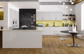 Modern U- shaped kitchen in hi-gloss grey. The lemon glass splash-back compliments the sort grey doors to give a fresh, light and airy feel.