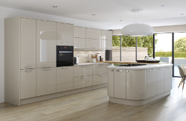 This high gloss modern kitchen works well in providing plenty of storage cupboards and island with abridging oak worktop feature for adaquate preparation surfaces.
