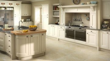 Create a peaceful haven by using a single colour throughout to reflect a classic kitchen design. The 2 stainless steel single ovens, american fridge-freezer and accessories all work well to retain a light airy feel.