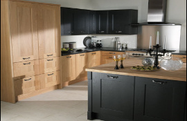 Simple. elegant and stylish - these oak doors have been mixed with black painted doors with matching reversed worktops gives a breathtaking unusual originality to this modern styled kitchen.