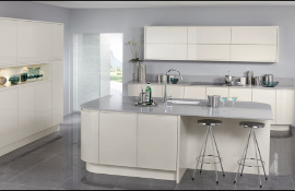 Latte gloss kitchen with pale grey silestone work surface curved to give a smooth flow to the design..