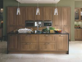 Medium walnut doors with pan drawers results in an affordable stylish modern kitchen.